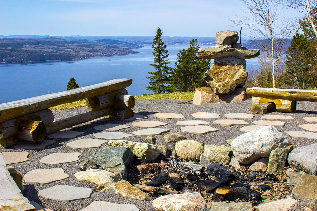 Enjoy a camp fire while appreciating the sunset and stars over the fjords in Sainte-Rose-du-Nord.